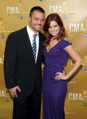 JoAnna Garcia and Nick Swisher attend the 44th Annual CMA Awards at the Bridgestone Arena on November 10 2010 in Nashville Tennessee