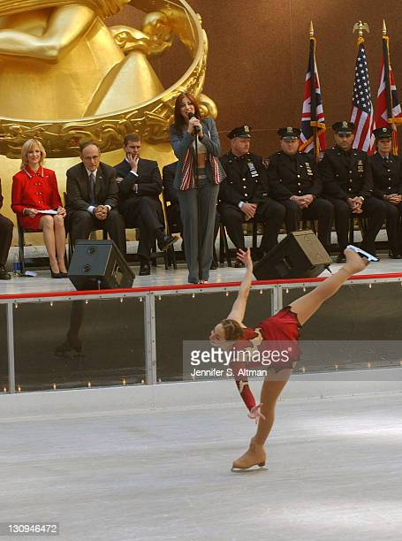 Joanna Glick skates and Deborah Gibson sings 'What Makes a Hero' as Mayor Giuliani second from left HRH Prince Andrew third from left and rescue...