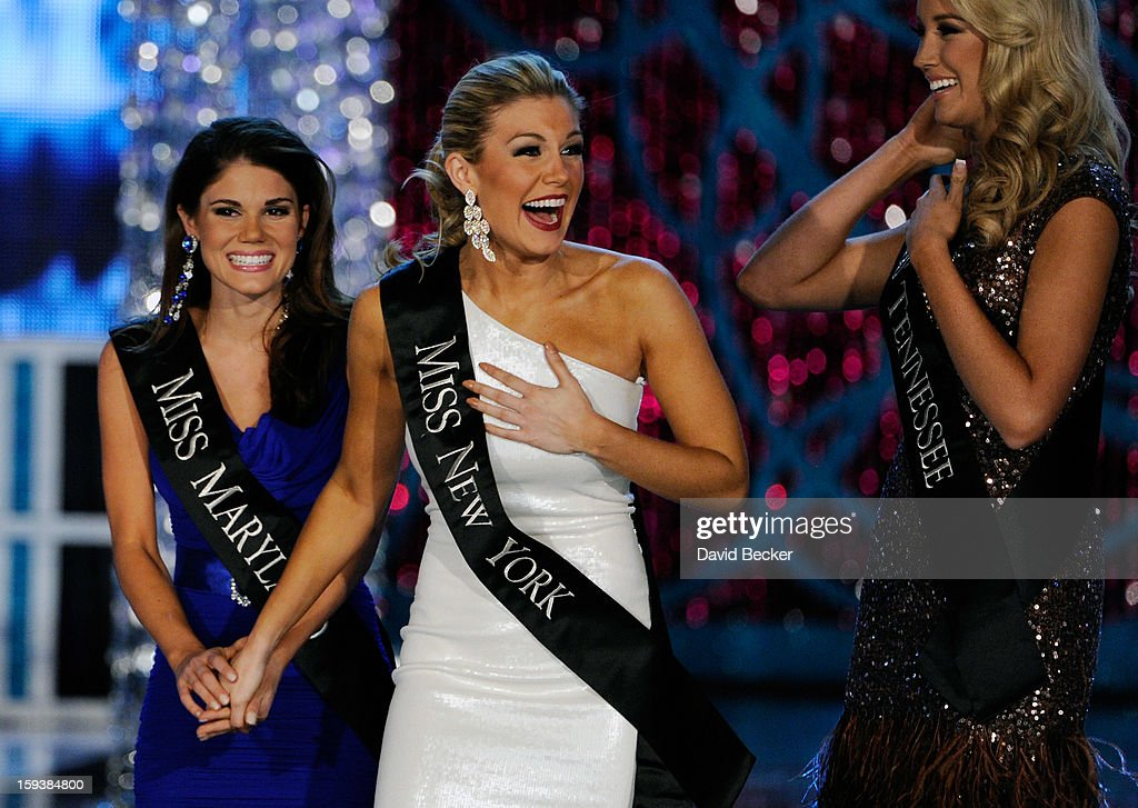 Joanna Guy (L), Miss Maryland, and Chandler Lawson (R), Miss Tennessee, congratulate Mallory Hytes Hagan, Miss New York, as she reacts during the 2013 Miss America Pageant at PH Live at Planet Hollywood Resort & Casino on January 12, 2013 in Las Vegas, Nevada.