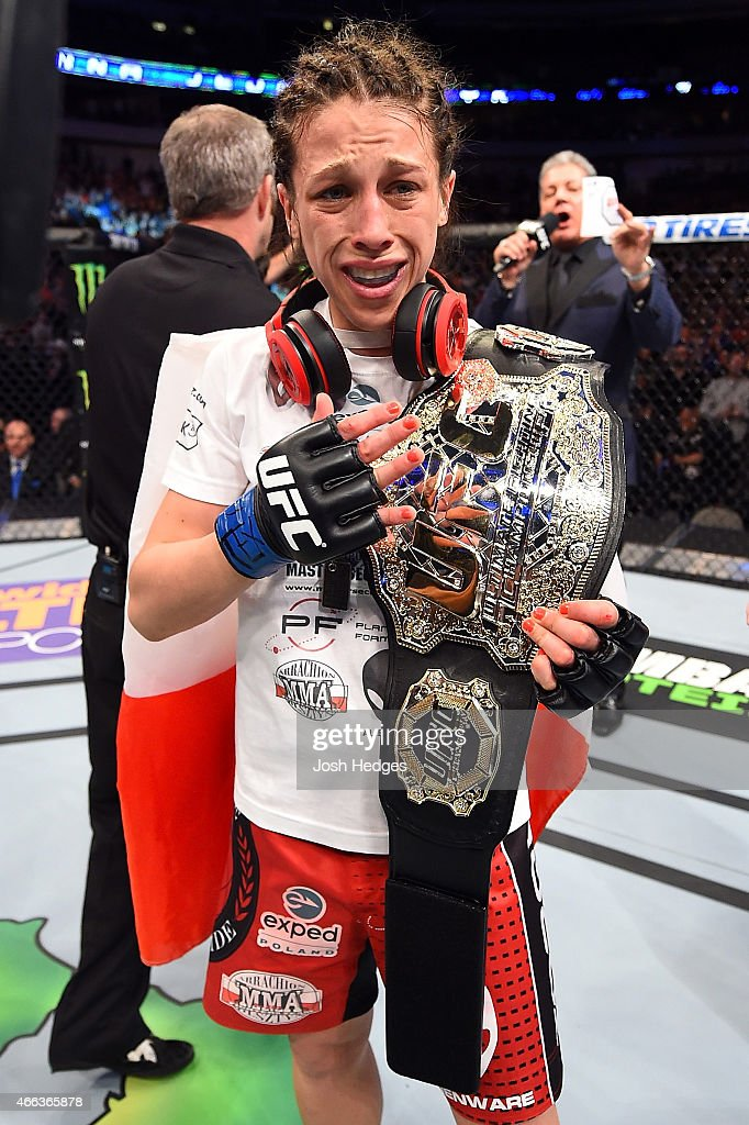 Joanna Jedrzejczyk celebrates after becoming the UFC Women's Strawweight Champion after defeating Carla Esparza by TKO during the UFC 185 event at...