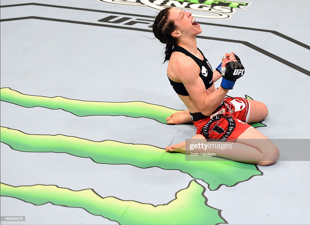 Joanna Jedrzejczyk celebrates after defeating Carla Esparza by TKO in their UFC women's strawweight championship bout during the UFC 185 event at the...