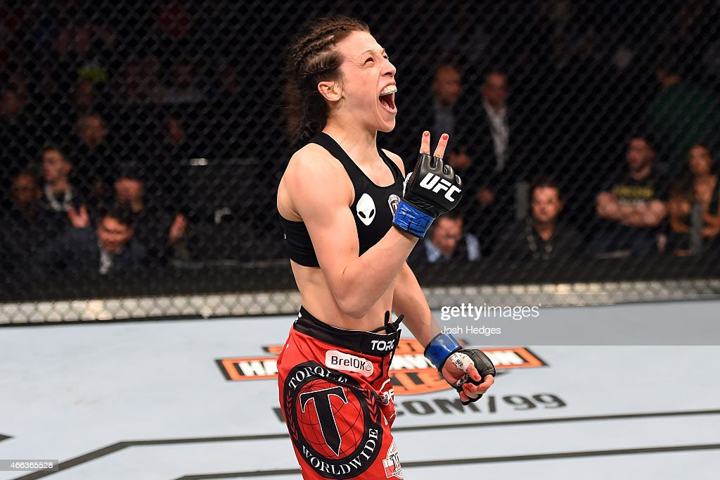 Joanna Jedrzejczyk celebrates after defeating Carla Esparza by TKO in their UFC women's strawweight championship bout during the UFC 185 event at the American Airlines Center on March 14, 2015 in Dallas, Texas.