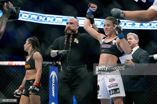 Joanna Jedrzejczyk celebrates after defeating Julianna Lima in their women's strawweight bout during the UFC Fight Night event at the SAP Center on...