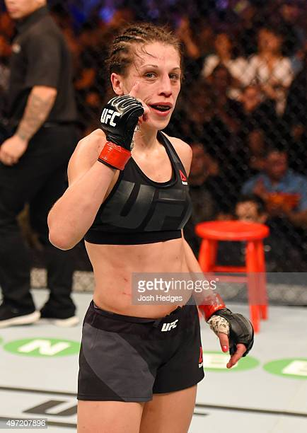 Joanna Jedrzejczyk celebrates her championship win by Unanimous Decision after five rounds against Valerie Letourneau in their UFC women's...