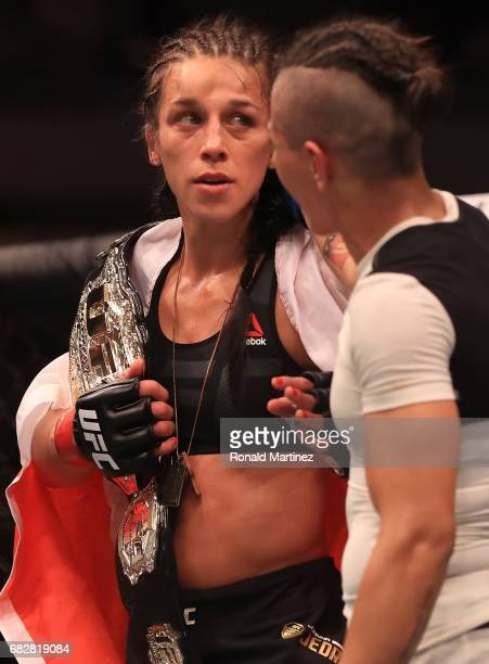 Joanna Jedrzejczyk celebrates her win in the Women's Strawweight Title bout against Jessica Andrade during UFC 211 at American Airlines Center on May...