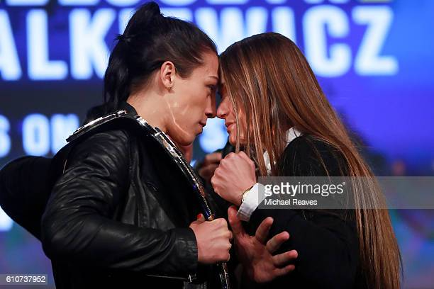 Joanna Jedrzejczyk faces off with Karolina Kowalkiewicz during the UFC 205 press conference at The Theater at Madison Square Garden on September 27...
