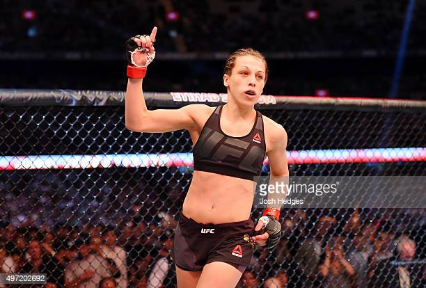 Joanna Jedrzejczyk holds up one finger from the Octagon before facing Valerie Letourneau in their UFC women's strawweight championship bout during...