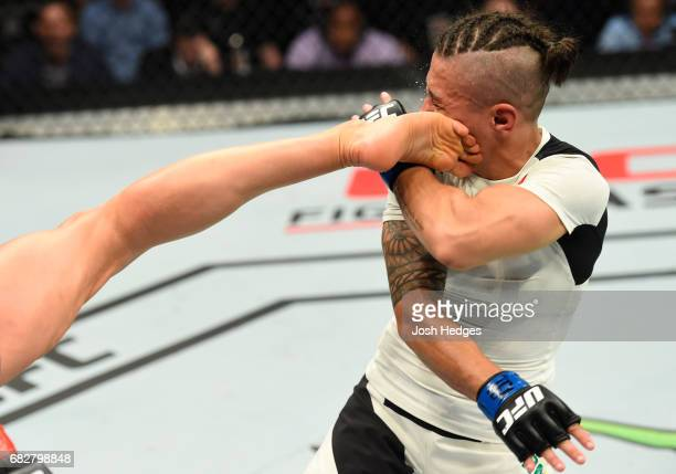 Joanna Jedrzejczyk kicks Jessica Andrade in their UFC women's strawweight championship fight during the UFC 211 event at the American Airlines Center...