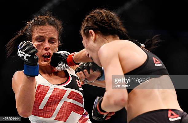 Joanna Jedrzejczyk lands a righthanded punch against Valerie Letourneau in their UFC women's strawweight championship bout during the UFC 193 event...