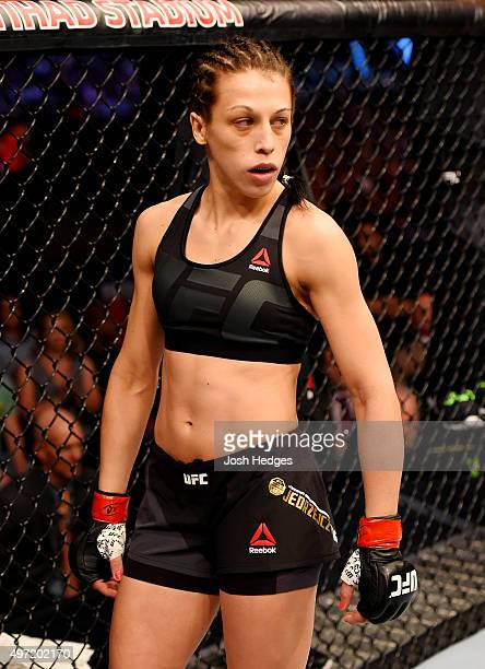 Joanna Jedrzejczyk looks on from the Octagon before facing Valerie Letourneau in their UFC women's strawweight championship bout during the UFC 193...