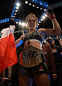 Joanna Jedrzejczyk of Poland celebrates after her victory over Claudia Gadelha in their women's strawweight championship bout during The Ultimate...