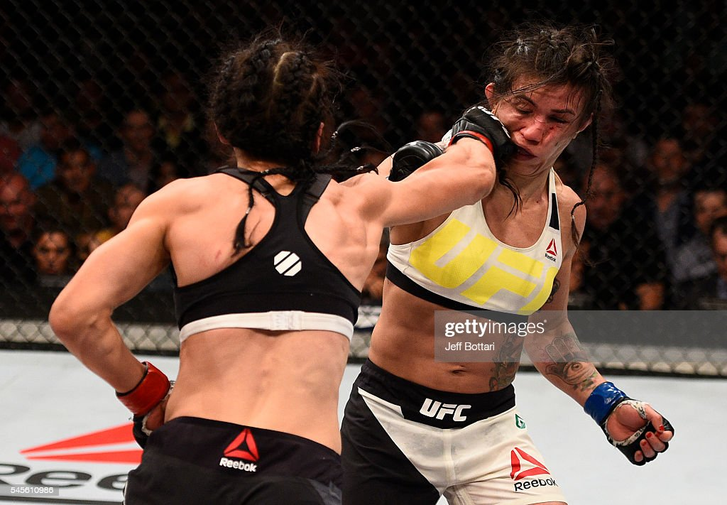 Joanna Jedrzejczyk of Poland punches Claudia Gadelha of Brazil in their women's strawweight championship bout during The Ultimate Fighter Finale...