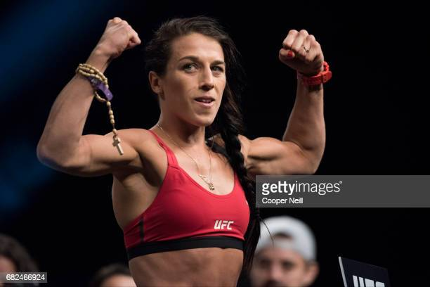 Joanna Jedrzejczyk poses on the scale during the UFC 211 weighin at the American Airlines Center on May 12 2017 in Dallas Texas