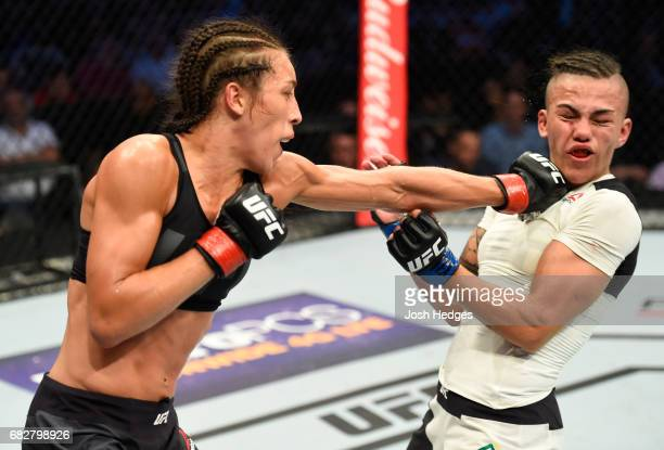 Joanna Jedrzejczyk punches Jessica Andrade in their UFC women's strawweight championship fight during the UFC 211 event at the American Airlines...