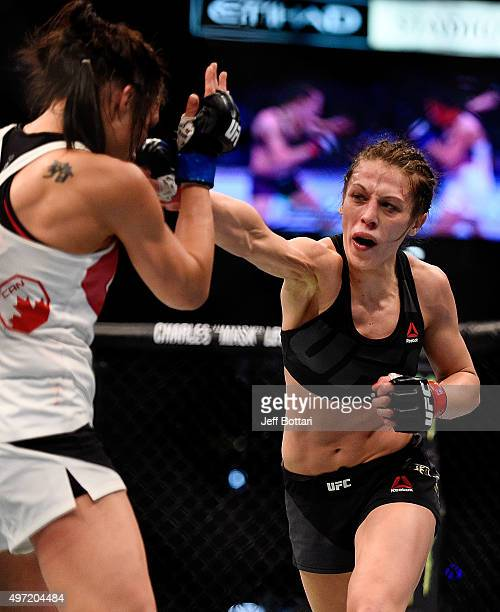 Joanna Jedrzejczyk throws a righthanded punch against Valerie Letourneau in their UFC women's strawweight championship bout during the UFC 193 event...