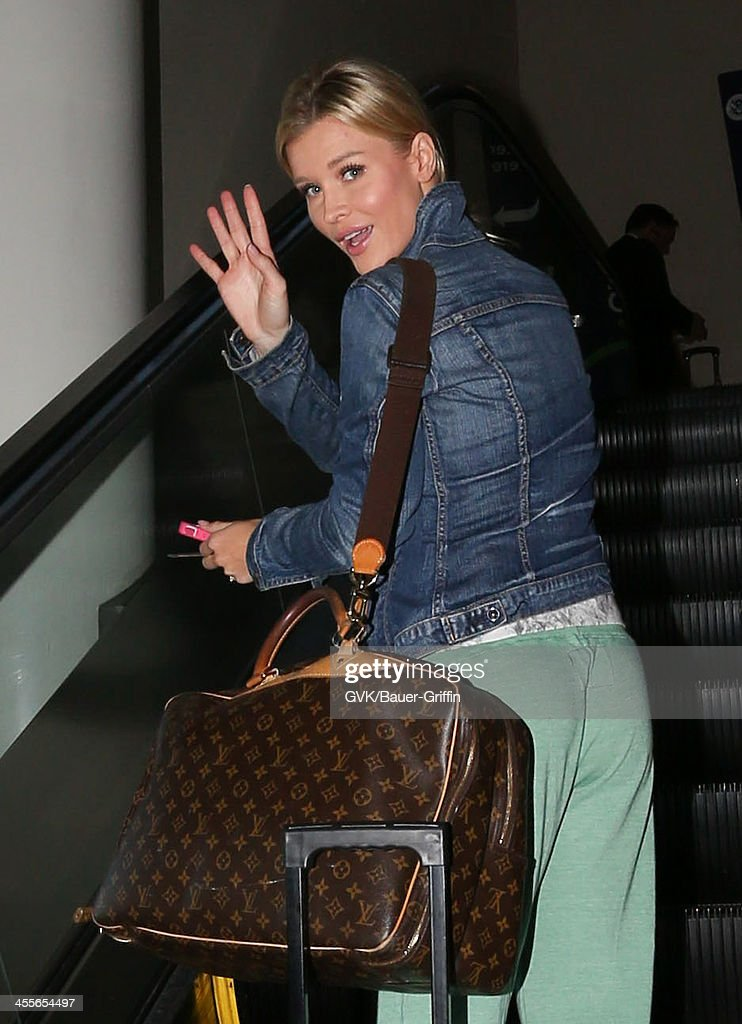 Joanna Krupa is seen at LAX on December 12, 2013 in Los Angeles, California.