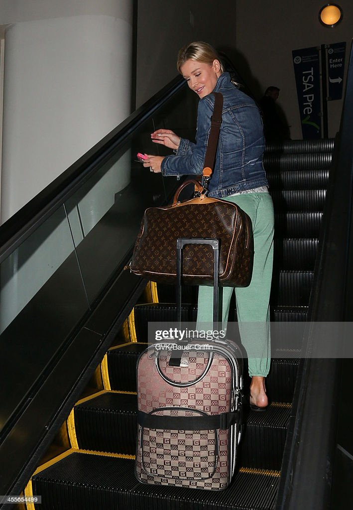 Joanna Krupa is seen at LAX on December 12, 2013 in Los Angeles, California.