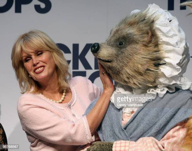 Joanna Lumley and a cast member of Tales of Beatrix Potter attends a photocall for Tickets For Troops at the Royal Opera House on January 11 2010 in...