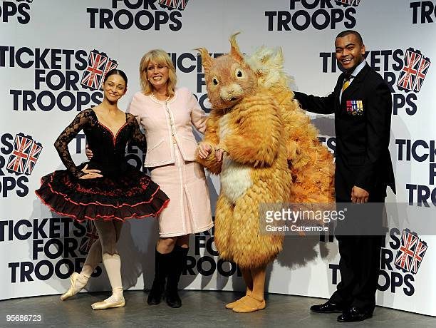 Joanna Lumley and Johnson Beharry VC attend a photocall to launch 'Tickets For Troops' at the Royal Opera House on January 11 2010 in London England...