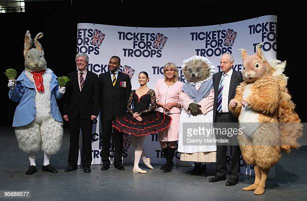 Joanna Lumley Johnson Beharry VC and cast members of Tales of Beatrix Potter attend a photocall for Tickets For Troops at the Royal Opera House on...