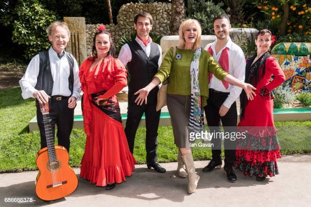 Joanna Lumley poses with traditional Spanish flamenco dancers accompanied by Spanish guitar perform at the RHS Chelsea Flower Show on May 22 2017 in...