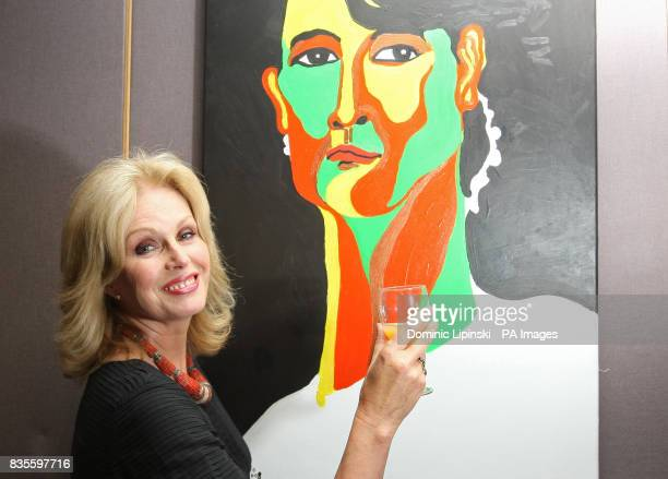 Joanna Lumley stands in front of a portrait of Burmese opposition leader Aung San Suu Kyi by Burmese artist Htein Lin at an event to celebrate Suu...