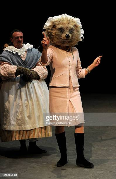 Joanna Lumley wearing part of a costume for Beatrix Potter character Mrs TiggyWinkle attends a photocall to launch 'Tickets For Troops' at the Royal...