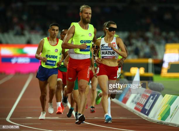Joanna Mazur of Poland and Guide Michal Stawicki compete Women's 1500m T11 Final during World Para Athletics Championships Day Three at London...