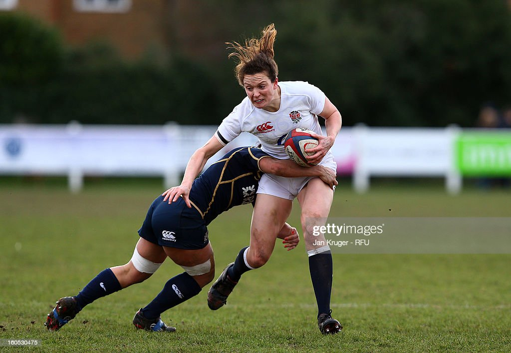 Joanna McGilchrist of England Women is tackled during the Womens Six Nations match between England and Scotland at Esher RFC on February 2, 2013 in Esher, England.