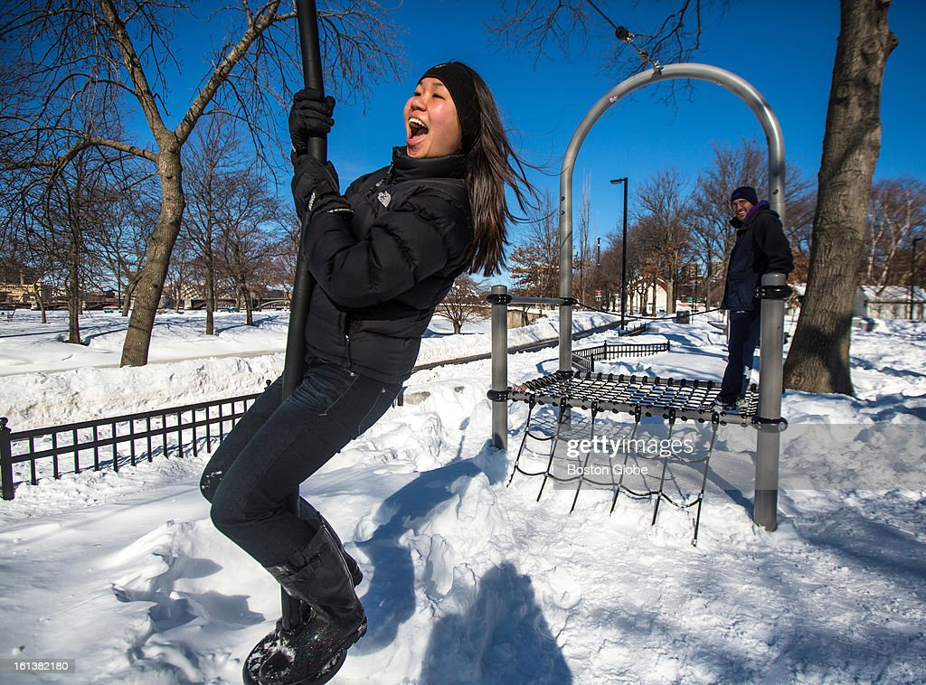 Joanna Ng-Glazier, a doctor at a local Boston hospital, rode a zip line on The Esplanade in Boston while her husband, Scott Glazier, also a doctor at a local hospital, watched, after a blizzard dropped over two feet of snow in the area, Sunday, Feb. 10, 2013.