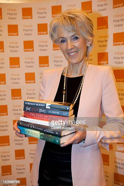 Joanna Trollope author and chair of the Orange Prize for Fiction Awards holds the six novels shortlisted for the prize The shortlist of authors Esi...