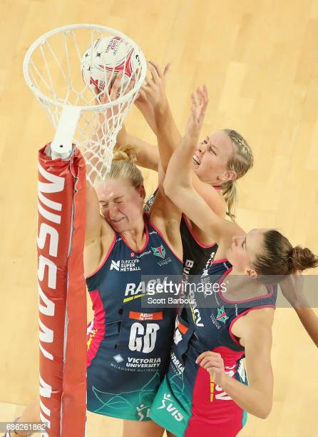 Joanna Weston of the Vixens and Sasha Glasgow of the Thunderbirds compete for the ball during the round 13 Super Netball match between the Vixens and...