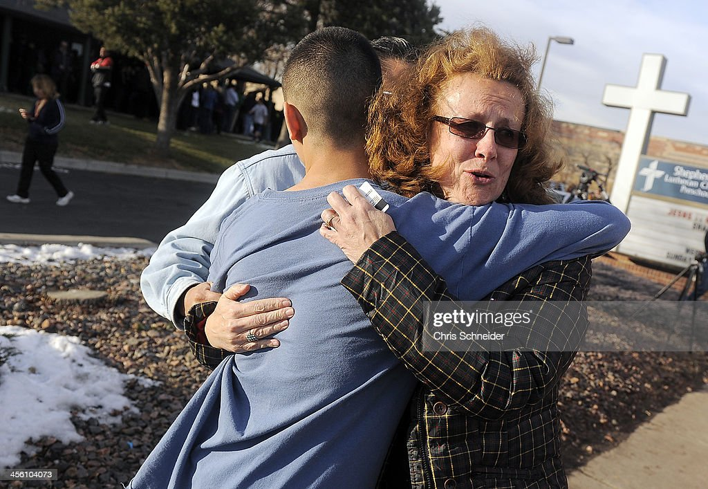 JoAnne Allen, right, hugs her son Alex Allen, 17, after a school shooting on December 13, 2013 at Arapahoe High School in Centennial, Colorado. According to authorities, two students were injured by a lone gunman who later died of a self-inflicted gun shot wound.