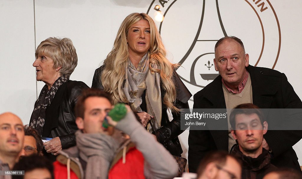 Joanne Beckham, David Beckham sister stands between her parents, Sandra Georgina West aka Sandra Beckham and Ted Beckham who are divorced during the Champions League match between Paris Saint Germain FC and Valencia CF at the Parc des Princes stadium on March 6, 2013 in Paris, France.