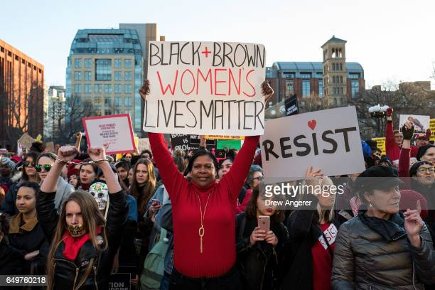 JoAnne Bellamy from Virginia Beach Virginia holds up a sign supporting minority women's rights to mark International Women's Day in Washington Square...