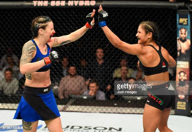 Joanne Calderwood of Scotland and Cynthia Calvillo high five in their women's strawweight bout during the UFC Fight Night event at the SSE Hydro...