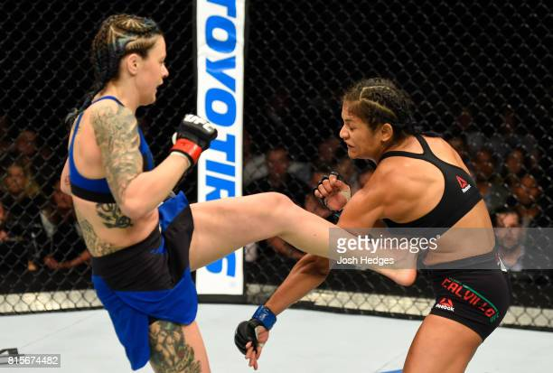 Joanne Calderwood of Scotland kicks Cynthia Calvillo in their women's strawweight bout during the UFC Fight Night event at the SSE Hydro Arena...