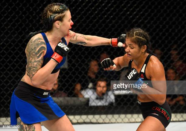 Joanne Calderwood of Scotland punches Cynthia Calvillo in their women's strawweight bout during the UFC Fight Night event at the SSE Hydro Arena...