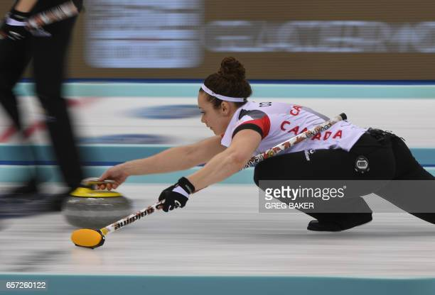 TOPSHOT Joanne Courtney of Canada releases the stone during their match against Russia at the Women's Curling World Championships in Beijing on March...
