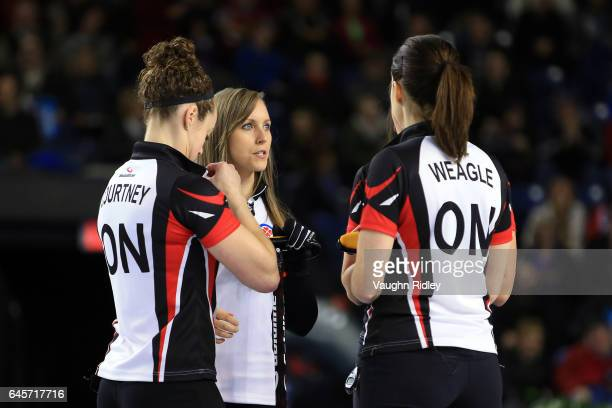 Joanne Courtney Rachel Homan Emma Miskew and Lisa Weagle of Ontario talk during a break in play in the Gold Medal match against Manitoba during the...