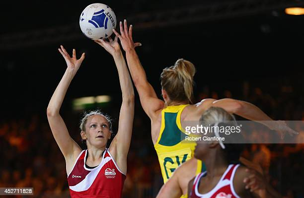 Joanne Harten of England is challenegd by Laura Geitz of Australia during the Pool B netball match between Australia and England at SECC Precinct...