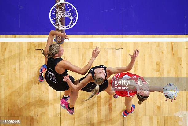 Joanne Harten of England is challenged by Casey Kopua and Katrina Grant of New Zealand during the 2015 Netball World Cup Semi Final 1 match between...