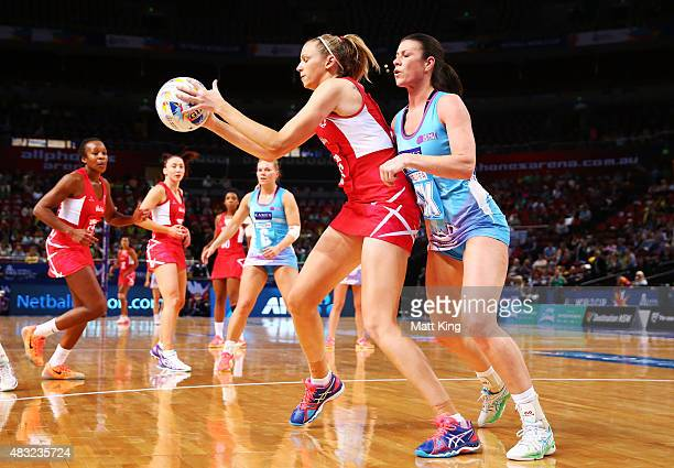 Joanne Harten of England is challenged by Hayley Mulheron of Scotland during the 2015 Netball World Cup match between England and Scotland at...