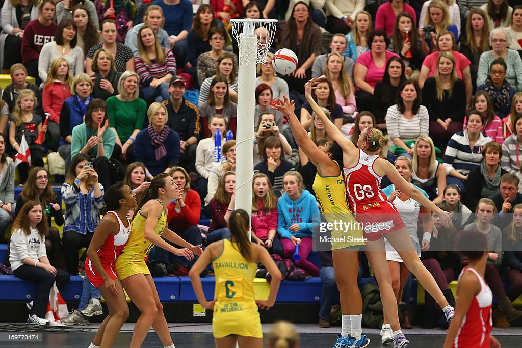 Joanne Harten (R)of England shoots during the England v Australia International Netball Series match at the University of Bath on January 20, 2013 in Bath, England.