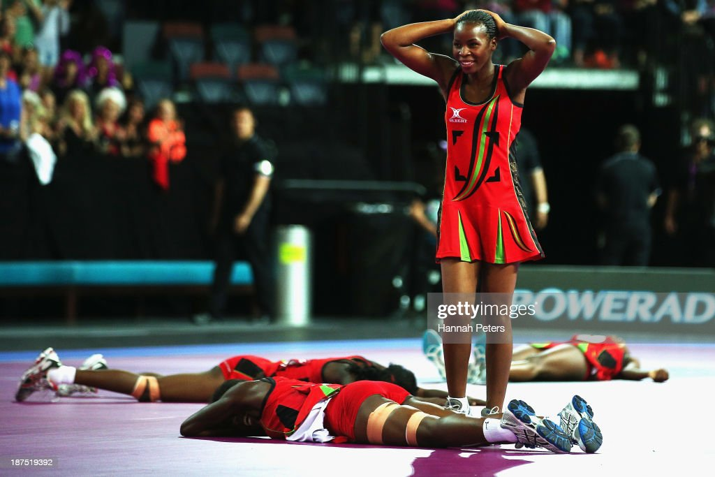 Joanne Kachilika of Malawi celebrates after winning the 5th/6th playoff match between Malawi and England on day three of the Fast5 Netball World Series at Vector Arena on November 10, 2013 in Auckland, New Zealand.