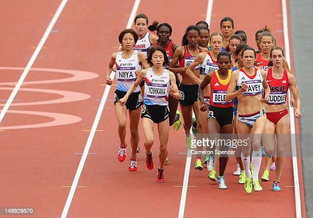 Joanne Pavey of Great Britain leads the pack ahead of Hitomi Niiya and Mika Yoshikawa of Japan in the Women's 5000m round 1 heats on Day 11 of the...