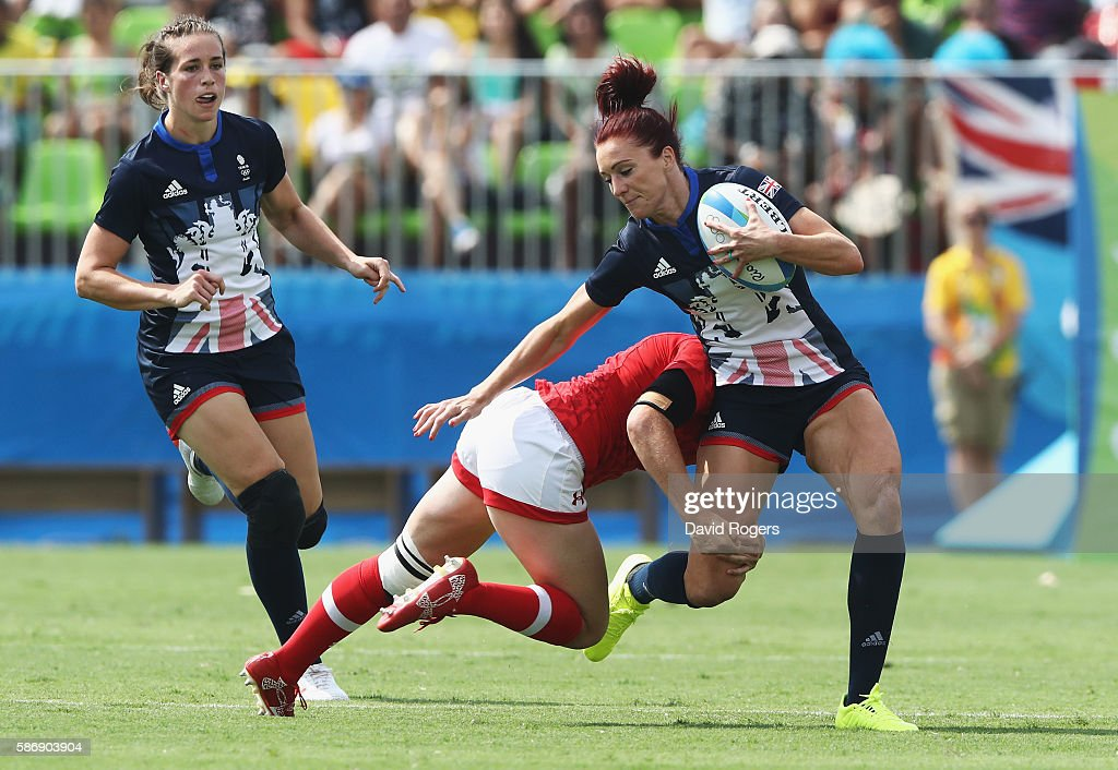 Joanne Watmore of Great Britain runs with the ball under pressure during the Women's Pool C rugby match against Canada on Day 2 of the Rio 2016...