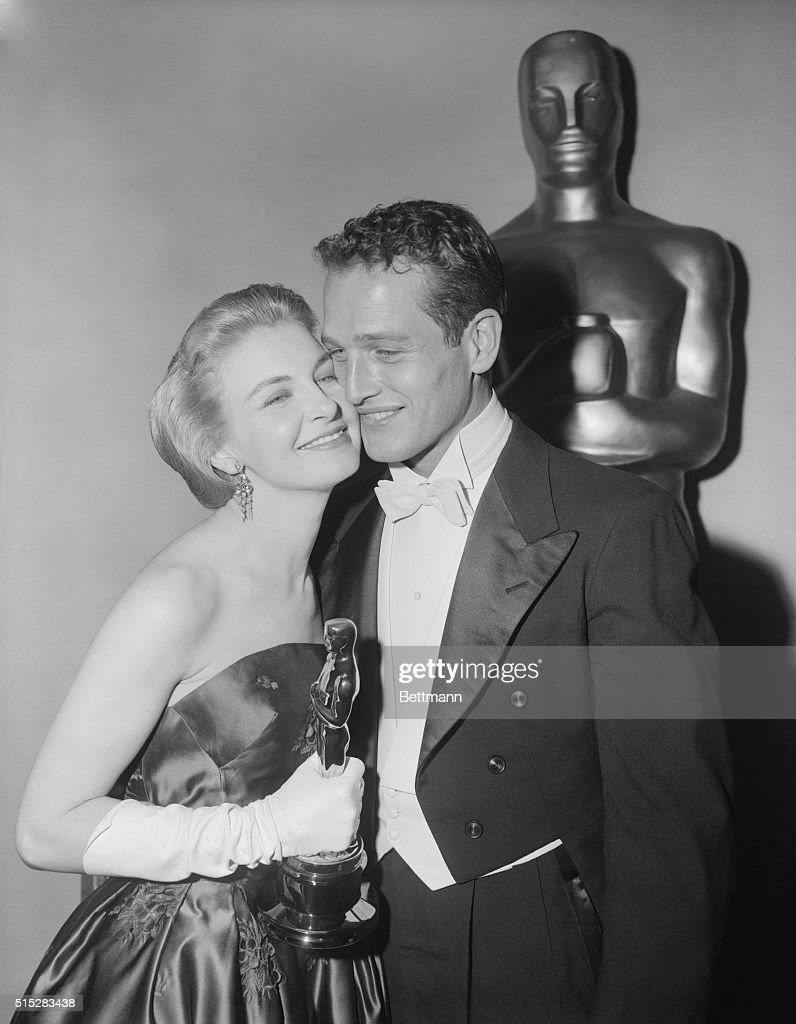 Joanne Woodward arrives at the Pantages Theatre tonight with her husband, actor Paul Newman, for the 30th Annual Academy Awards. Joanne walked away with the Best Actress of the Year Award when she was presented with her 'Oscar' for her portrayal in The Three Faces of Eve.