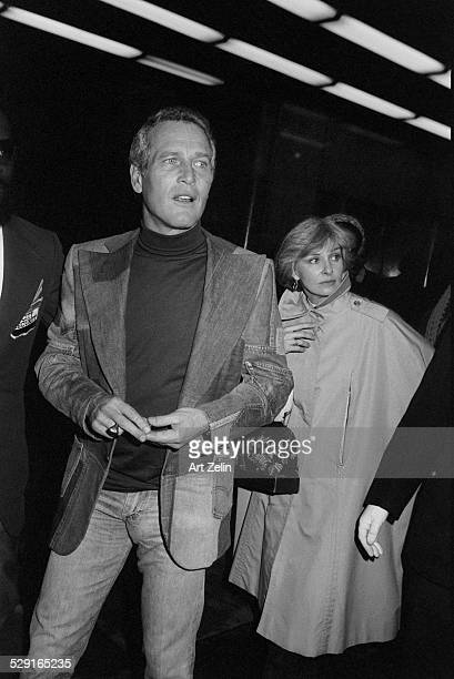 Joanne Woodward walking with Paul Newman and security circa 1980 New York