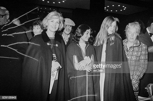 Joanne Woodward wearing a cape with two of her daughters circa 1970 New York